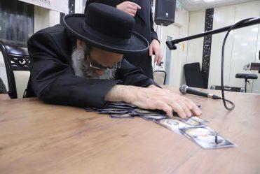 Rav Gamliel Rabinowitz at Chanukah Licht at'Bayis Lepleitos' on First Night of Chanukah. He Then Led Dreidel and Distributed Gelt.